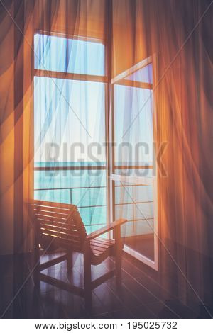 Hotel room with a sea view house near the sea in the environmental location on the island. The window overlooking the ocean. The endless expanse of the sea. Place for a romantic holiday. Toning in vintage style.
