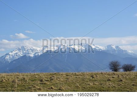 Bucegi Mountains in spring time.Bucegi mountain landscape in the winter season with snow covering the trees and the mountains in Romania
