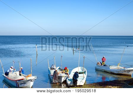 CAMPECHE MEXICO FEBRUARY 24: Group of fishermen on the shore close to Champoton Mexico on February 24 2017
