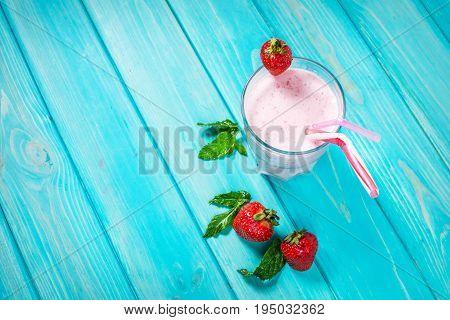 Strawberries milk shake and fresh fruit strawberry. Cocktail with milk.