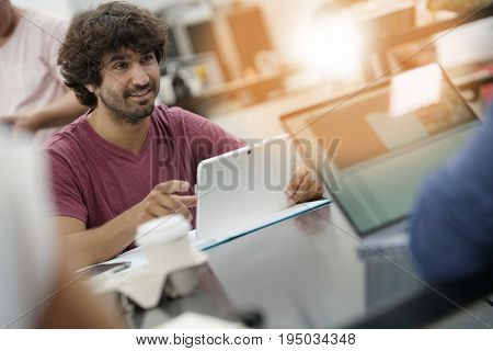 Young entrepreneur man working in office on laptop