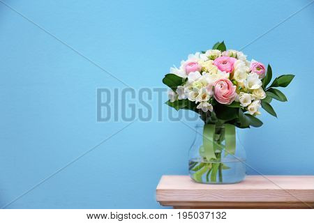 Beautiful bouquet with white freesia on light background