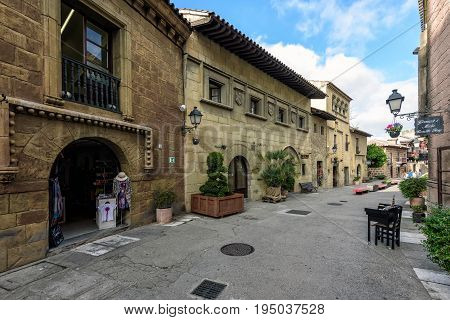 BARCELONA, SPAIN - MAY 2017: Traditional street of medieval Spanish village at Barcelona town, Catalonia, Spain