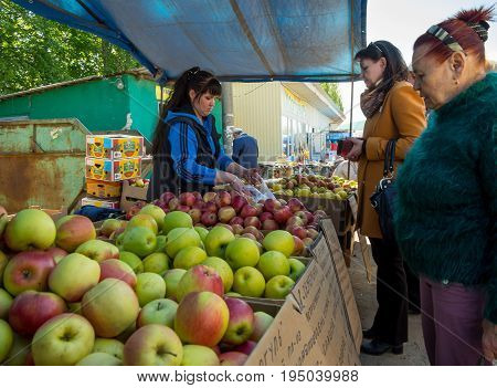 Voronezh, Russia - May 13, 2017: Women buy apples at the