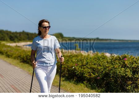 Nordic walking - middle-aged woman working out