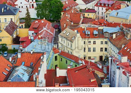 Beautiful Colorful Buildings With Red Tile Roofs In Vilnius Old Town