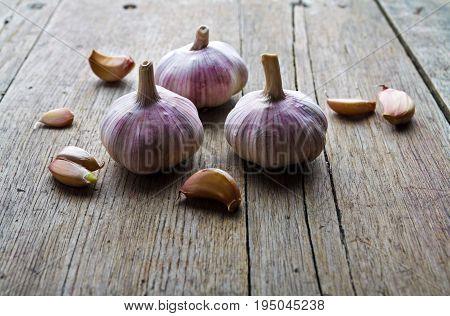 garlic on wooden table. pungent garlic on wooden background