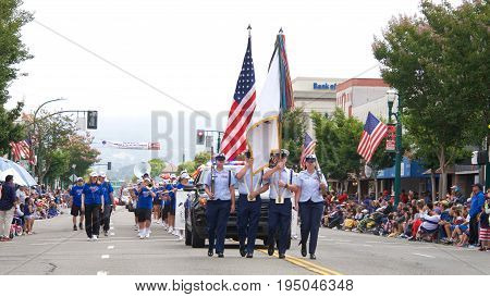 Alameda CA - July 04 2017: The Alameda 4th of July Parade is one of the largest and longest Independence Day parade in the nation. Color Guard leads the parade down Park Street.