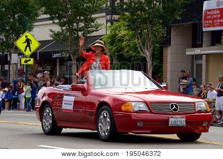 Alameda CA - July 04 2017: The Alameda 4th of July Parade is one of the largest and longest Independence Day parade in the nation. Council member Marilyn Ezzy Ashcraft waves to the crowd.