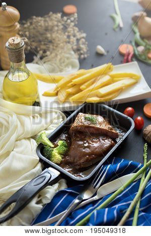 Fresh Grilled Meat. Grilled Beef Steak In The Pan, French Fries And Mashed Potato With Spoon, In Ser
