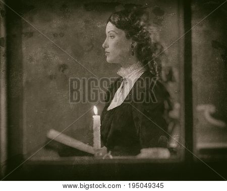Worn Wet Plate Photo Of Victorian Girl Reading Book By Candlelight Behind Window.