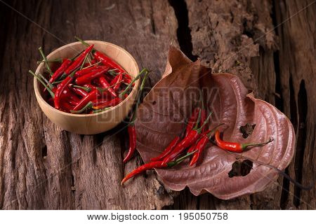 Red Hot Chili Peppers In Wooden Bowl On Wooden Background. Spicy Chilli Peppers