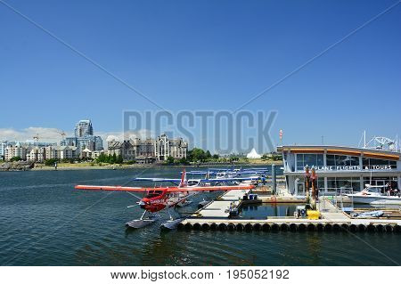 Victoria BC,Canada,June 28th 2017.Victoria 's inner harbor with  seaplanes waiting to take one on a flight or across the way to great accommodations and prime real estate viewing.Visit Victoria;s inner harbor and make friends.