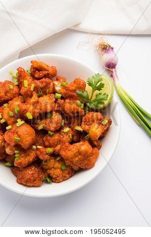 Gobi Manchurian dry - Popular street food of India made of cauliflower florets, selective focus