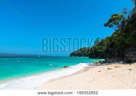BORACAY WESTERN VISAYAS PHILIPPINES - JANUARY 14 2015: Wide angle view of the tropical Puka Beach located in the north of the island of Boracay.