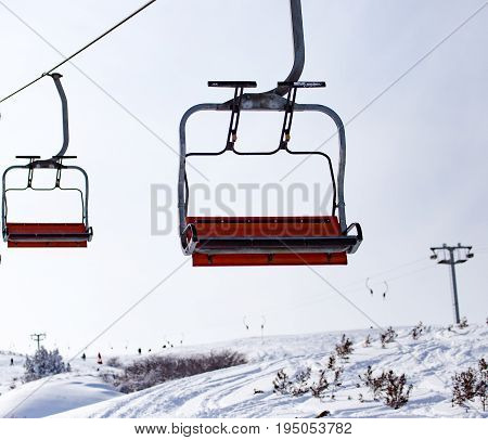 Ski lift in the mountains in winter .
