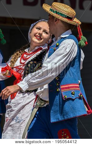ROMANIATIMISOARA - JULY 9 2017: Young Polish dancers in traditional costume perform in one show at the international folk festival