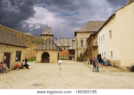 Khotyn Ukraine - 21 May 2017: Tourists walking inside of the Khotyn castle in Ukraine.