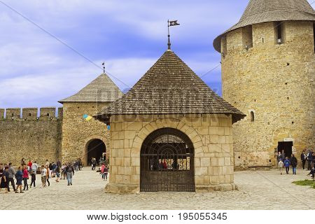 Khotyn Ukraine - 21 May 2017: Tourists walking inside of the Khotyn castle in Ukraine. The castle well is located in the center of the territory.