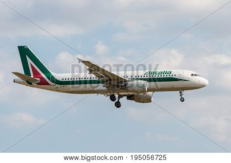 London UK - July 9 2017: Plane Airbus A320 Alitalia Airlines landing at London Heathrow Airport