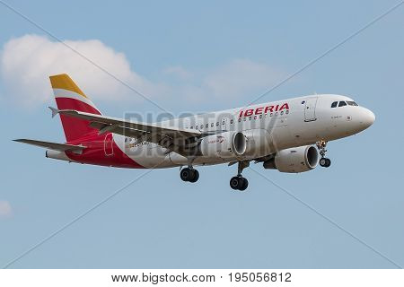 London UK - July 9 2017: Plane Airbus A319 Iberia Airlines landing at London Heathrow Airport