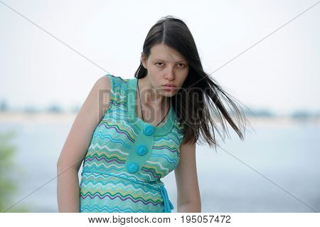 Pretty woman from Volgograd on the shore of the great Russian river Volga inflates her lips and shows her beautiful hair