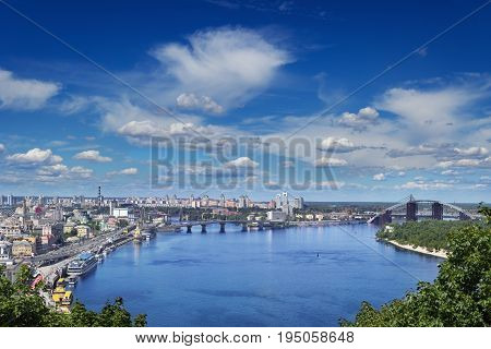 Cityspace of Kiev Ukraine. View on the Dnieper river bank and Podil leading to the two bridges.
