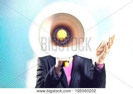 Closeup of a businessman speaking through megaphone