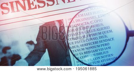 flared figure against close up of magnifying glass on newspaper paper
