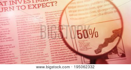 flared figure against cropped hand of person holding magnifying glass on graph chart
