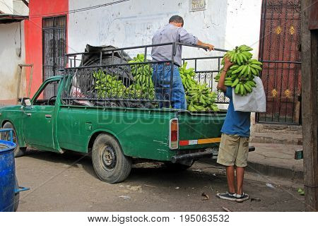 Delivering bananas in the colonial city of Leon, Nicaragua, Central America