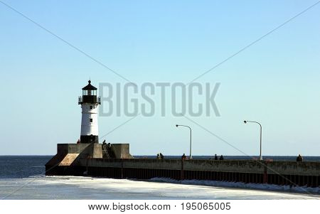 The lighthouse at the end of the North Pier in Duluth, Minnesota