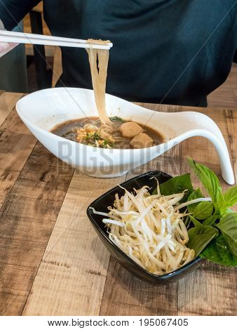 Beef Noodle Soup With Meat Ball Served With Bean Sprout And Holy Basil Vegetable.