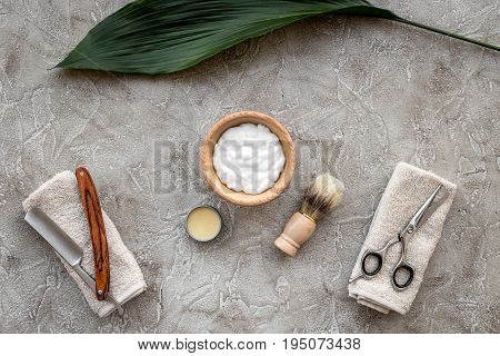 Preparing for men shaving. Shaving brush and razor on grey stone table background top view.