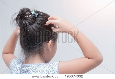 Little Girl Hand Itchy Scalp.