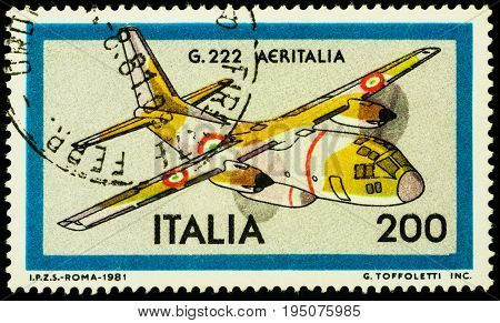 Moscow Russia - July 12 2017: A stamp printed in Italy shows Italian military transport aircraft Aeritalia G.222 series