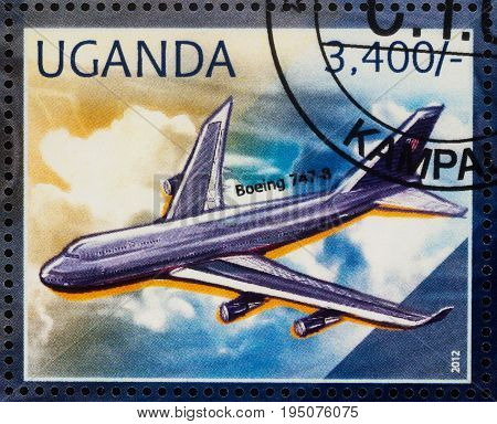Moscow Russia - July 10 2017: A stamp printed in Uganda shows airliner Boeing 747 series
