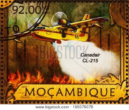 Moscow Russia - July 11 2017: A stamp printed in Mozambique shows firefighting amphibious aircraft Canadair CL-215 extinguishes forest fire series