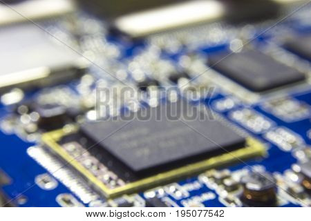 Abstract bokeh and blurred background of Chipset processing unit on electronic circuit board.