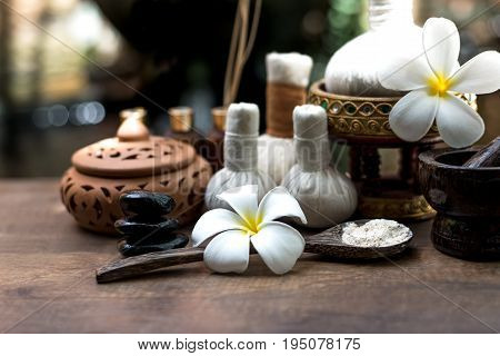 Thai Spa massage compress balls herbal ball and treatment spa relax and healthy care with flower Thailand. Healthy Concept. select focus