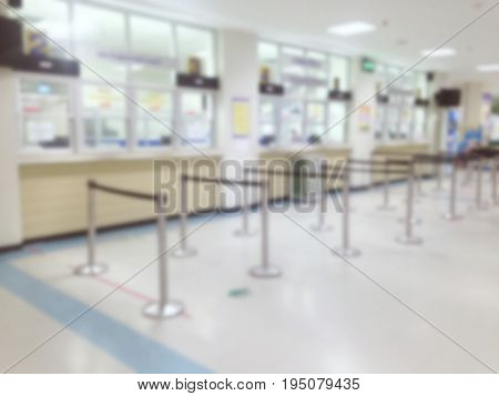 abstract blurred image of waiting zone for pay money and receive medicine at cashier pharmacy counter at hospital