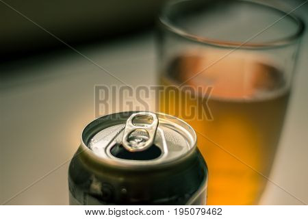 Can And Glass Of Beer Photograph