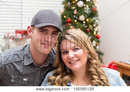 portrait of a young millennial couple at Christmas