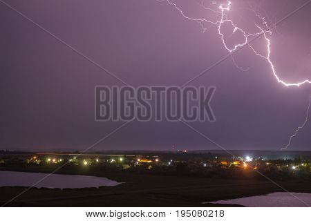 A beautiful discharge of lightning in the sky over the town