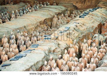 XI'AN SHAANXI PROVINCE CHINA - OCTOBER 28 2015: The Terracotta Warriors and remains of sculptures in corridors inside the Qin Shi Huang Mausoleum of the First Emperor of China.