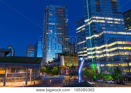 VANCOUVER CANADA - JUNE 25: City skyline after sunset near the West Building of Vancouver Convention Center on June 25 2017 in Vancouver Canada. The West Building has environmentally friendly living roof with native plants.