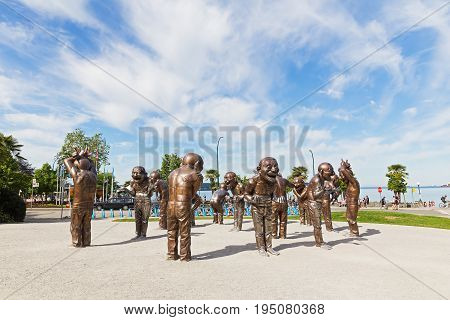 VANCOUVER CANADA - JUNE 25: A-maze-ing Laughter bronze sculpture in Morton Park on June 25 2017 in Vancouver Canada. The installation shows playfulness joy and range of motions in a state of laughter.