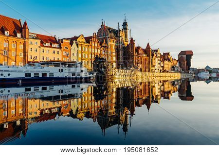 Sunrise view on the riverside of Motlawa river with wonderful buildings of Gdansk old town Poland