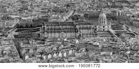 Aerial view of Paris from above with a Sacre Coeur on the horizon. .Black and white photo