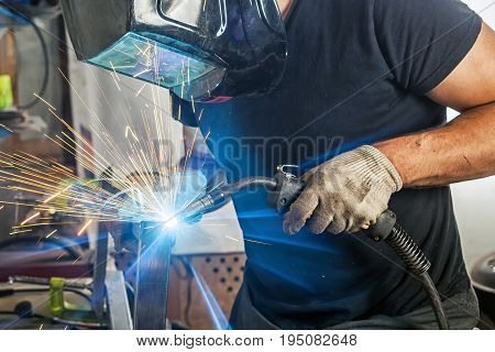 Man Weld A Metal Welding Machine